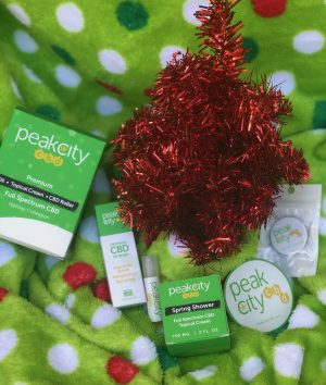 peak city cbd products laid on holiday-themed blanket